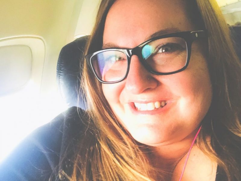 plus size woman flying while fat on an airplane