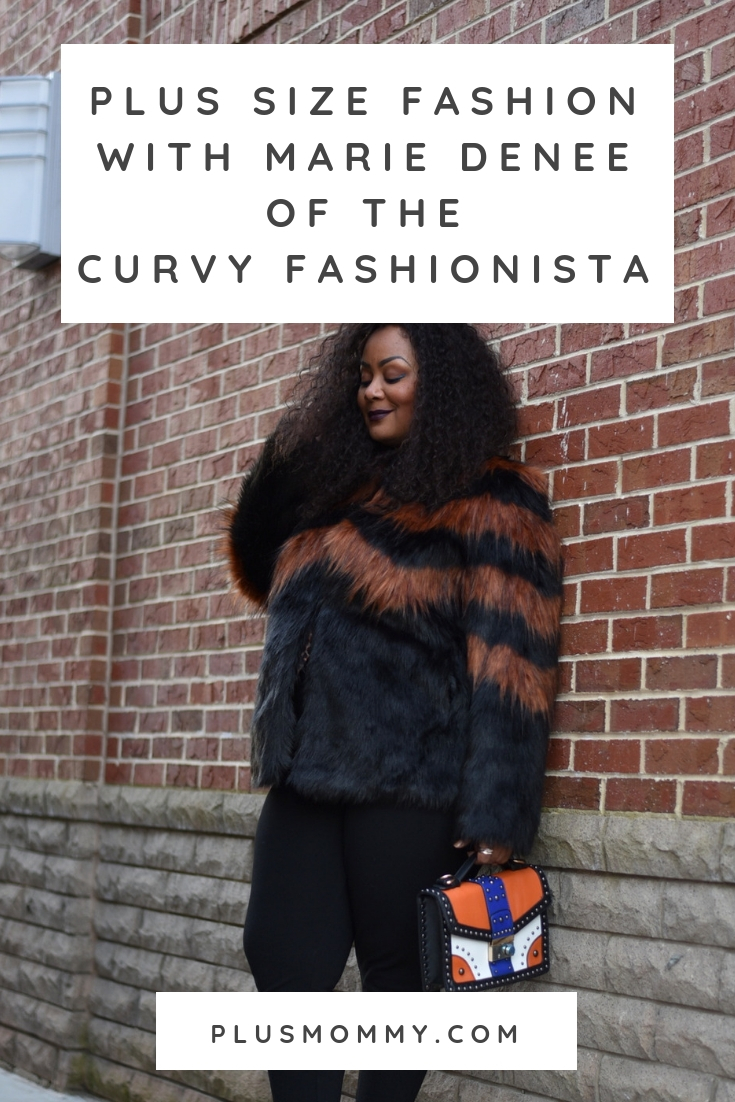 plus size fashionable woman against brick