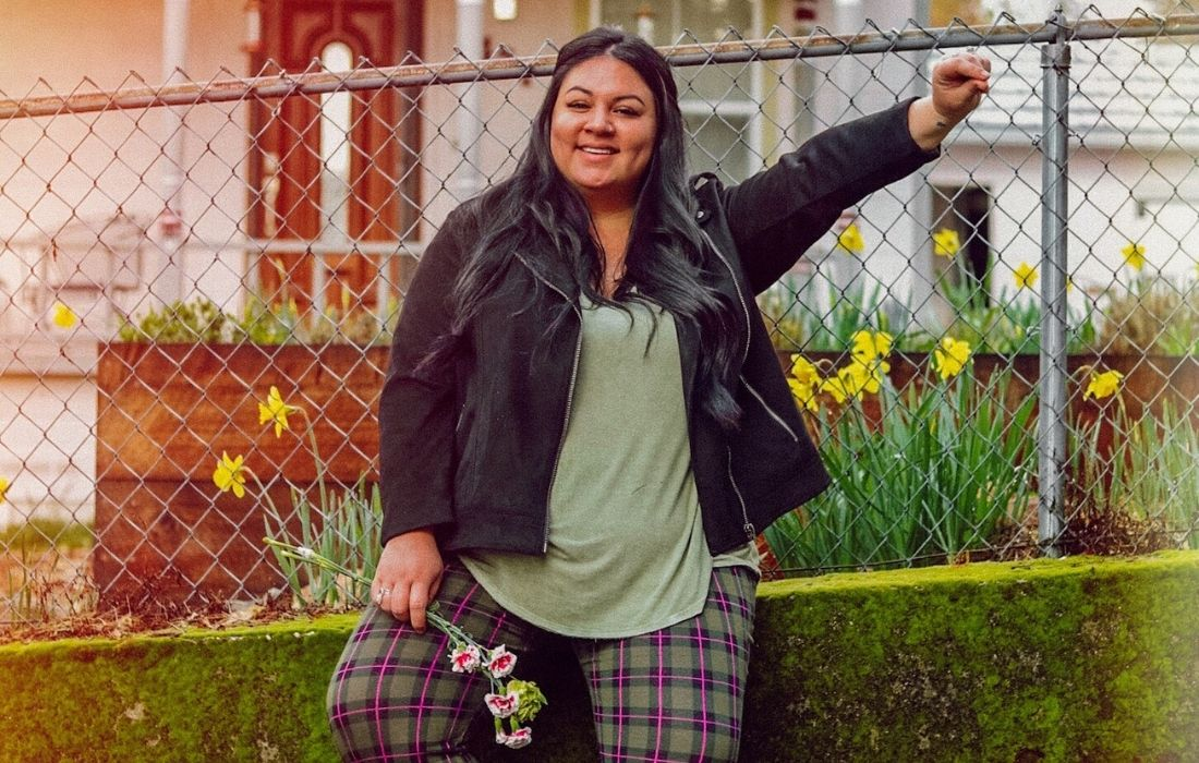 plus size woman standing outside smiling