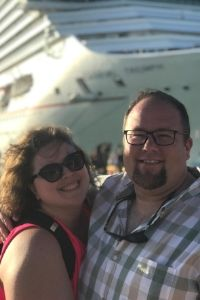 Picture of  Jimmy and Amanda of Chubby And Away in front of a cruise ship