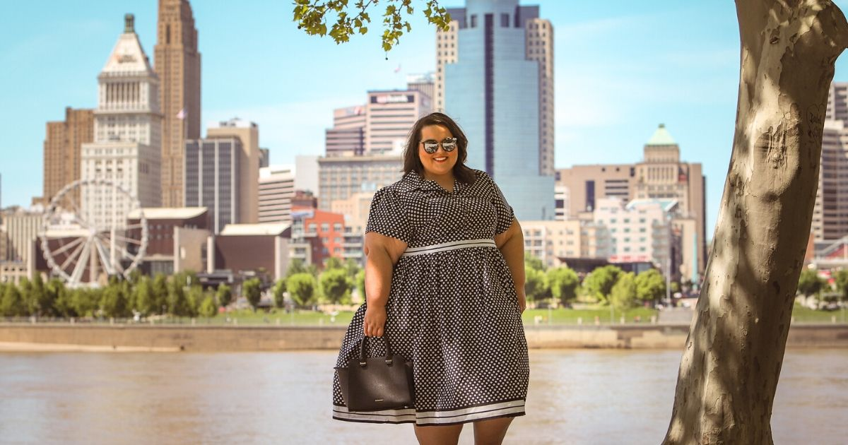 plus size woman standing by a river