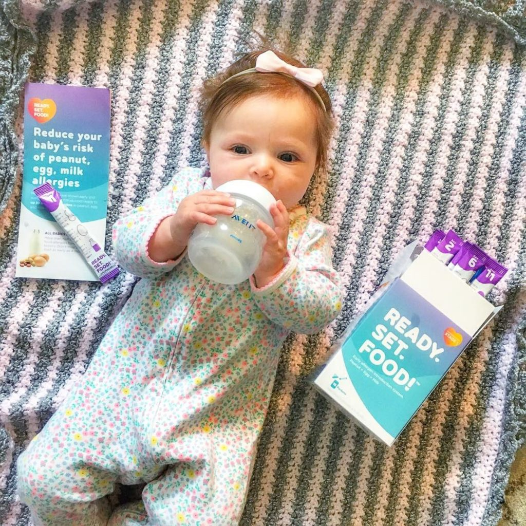 Baby with bottle drinking Read Set Food