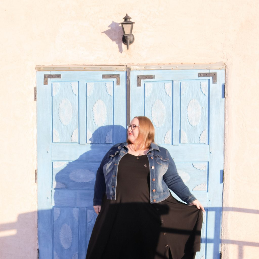 Jen McLellan standing in front of a blue door