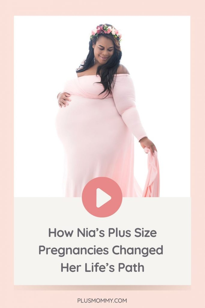 plus size pregnant woman wearing a pink plus size maternity gown