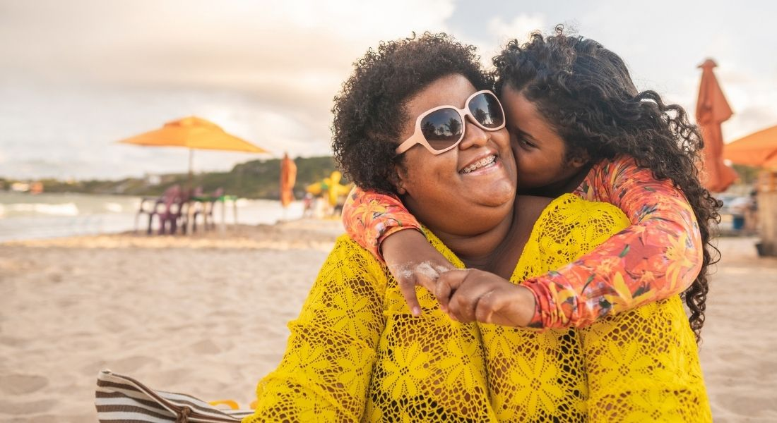 plus size mother and daughter smiling