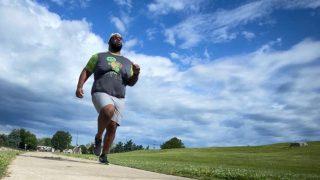 plus size man running outdoors